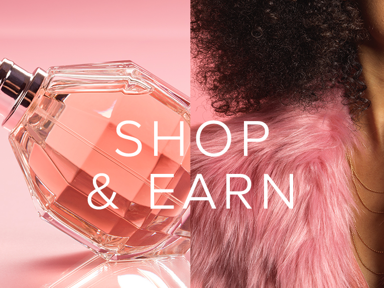 spring rewards pink furry vest and perfume bottle on a pink background